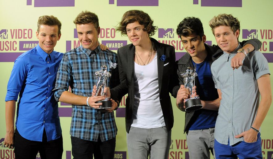 "FILE- In this Sept. 6, 2012, file photo, British band One Direction, from left, Louis Tomlinson, Liam Payne, Harry Styles, Zayn Malik and Niall Horan pose backstage after winning the awards for Best New Artist and Best Pop Video for the track, ""What Makes You Beautiful"" at the MTV Video Music Awards, Los Angeles. Malik said Wednesday, March 25, 2015, he is leaving chart-topping boy band One Direction ""to be a normal 22-year-old."" His bandmates said they were sad to see him go ""but we totally respect his decision and send him all our love for the future."" (Photo by Jordan Strauss/Invision/AP, File)"