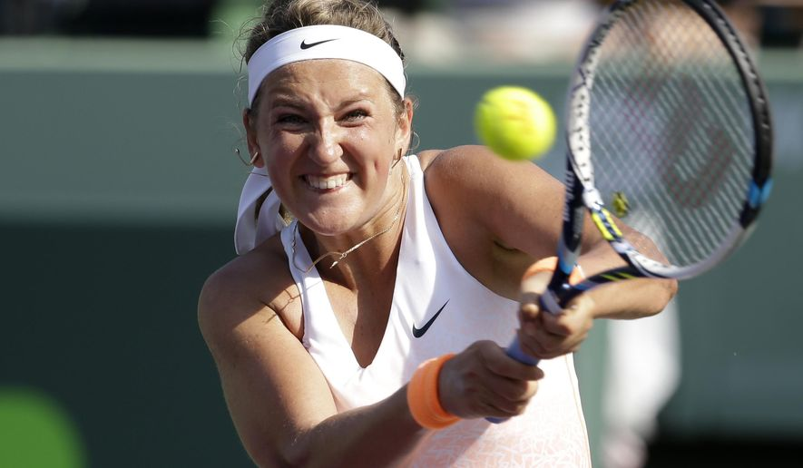 Victoria Azarenka, of Belarus, returns to Silvia Soler-Espinosa at the Miami Open tennis tournament, Wednesday, March 25, 2015, in Key Biscayne, Fla. (AP Photo/Lynne Sladky)