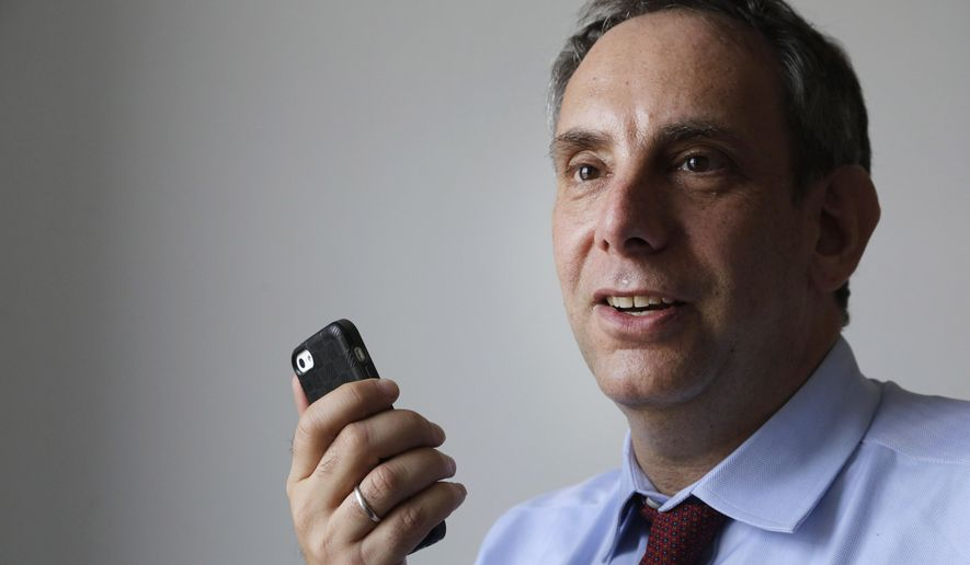 StoryCorps founder Dave Isay demonstrates how to record a story using a smartphone app Wednesday, March 25, 2015, in the Brooklyn borough of New York. Isay recently won the 2015 TED Prize of $1 million to help carry out his wish for a worldwide expansion of the StoryCorps project. After amassing a huge collection of recorded voices in the United States and creating a popular fixture on public radio, the national oral history project StoryCorps is going global. (AP Photo/Mark Lennihan)