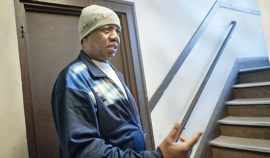 Fanuel Gumani, resident of Jackson Manor, talks to a reporter inside the building at 1700 Jackson Street in Sioux City, Iowa on Tuesday, March, 24, 2015. City inspectors shut down the apartment and gave residents nine hours to move out before midnight after an inspection earlier today. (AP Photo/Sioux City Journal, Justin Wan)