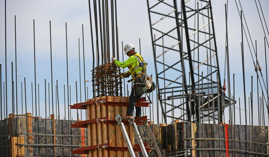 A large portion of the construction workforce in the District of Columbia and elsewhere across the nation is made up of Salvadorans with temporary protected status. (Associated Press/File)