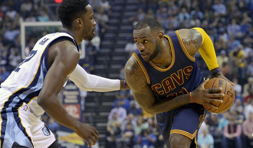 Cleveland Cavaliers forward LeBron James (23) controls the ball against Memphis Grizzlies forward Jeff Green (32) in the first half of an NBA basketball game Wednesday, March 25, 2015, in Memphis, Tenn. (AP Photo/Brandon Dill)