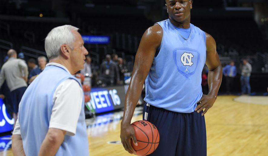 North Carolina head coach Roy Williams, left, talks with forward Joel James during practice, Wednesday, March 25, 2015, for a college basketball regional semifinal game in the NCAA Tournament in Los Angeles. North Carolina is scheduled to play Wisconsin on Thursday. (AP Photo/Mark J. Terrill)