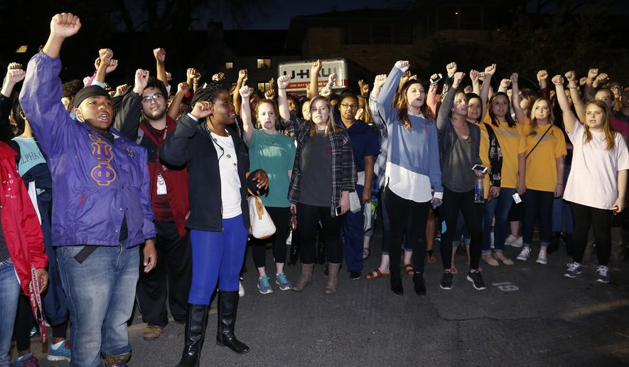 FILE - In this March 10, 2015 file photo, University of Oklahoma students gather outside the now closed University of Oklahoma's Sigma Alpha Epsilon fraternity house during a rally in reaction to members of the fraternity captured on video chanting a racial slur, in Norman, Okla. Oklahoma state Sen. Anastasia Pittman said former University of Oklahoma student Levi Pettit, who was shown in the video leading the racist chant, has reached out to her and plans to meet with black civic leaders to personally apologize for his role in the incident. (AP Photo/Sue Ogrocki, File)