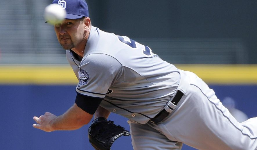 FILE - In this July 28, 2014, file photo, San Diego Padres' Jason Lane delivers to the Atlanta Braves during a baseball game in Atlanta. Lane gets the starting nod Wednesday, March 25, for the Padres against the Dodgers. The 38-year-old lefty is pitching in place of right-hander Ian Kennedy, who will throw in a minor league game to avoid facing a division rival. (AP Photo/David Tulis, File)