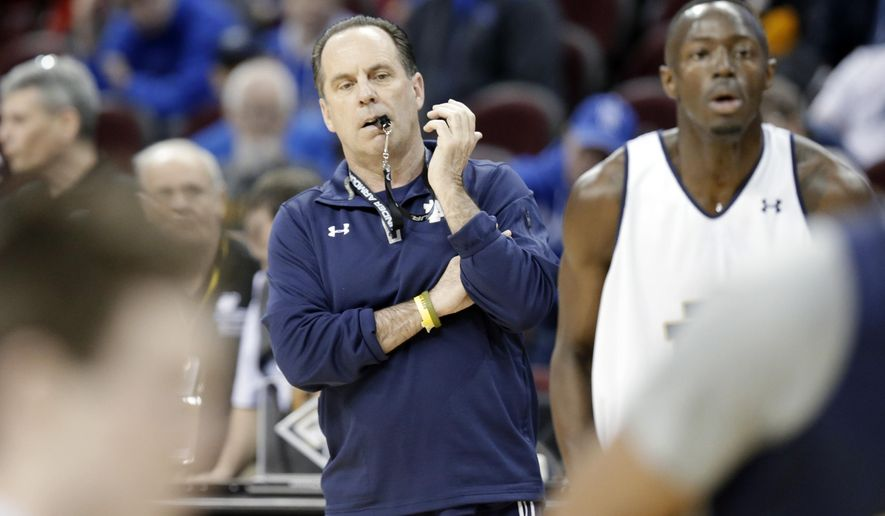 CORRECTS FIRST NAME TO MIKE, NOT MILE - Notre Dame head coach Mike Brey watches his team practice for a college basketball regional semifinal game in the NCAA Tournament in Cleveland, Wednesday, March 25, 2015. Notre Dame plays Wichita State on Thursday. (AP Photo/Tony Dejak)