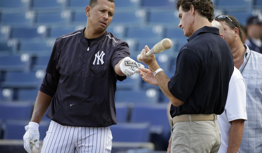 Former New York Yankees outfielder and broadcaster Paul O'Neill, right, inspects the bat belonging to New York Yankees designated hitter Alex Rodriguez after batting practice before an exhibition baseball game against the Detroit Tigers in Tampa, Fla., Tuesday, March 24, 2015. (AP Photo/Kathy Willens)