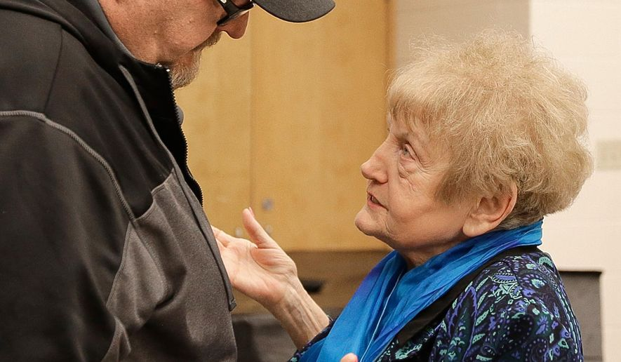 Eva Kor chats with former white supremacist Thomas Adams before her talk at West High in Billings, Mont., Tuesday, March 24, 2015. (AP Photo/Billings Gazette, Bob Zellar)