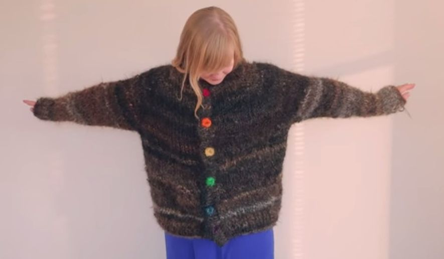 In an effort to combat homophobic language, the Canadian Centre for Gender and Sexual Diversity (CCGSD) has created a sweater it's showcasing at Toronto Fashion Week that has been knitted from the donated hair of more than 1,000 LGBT individuals. (YouTube/CCGSD)
