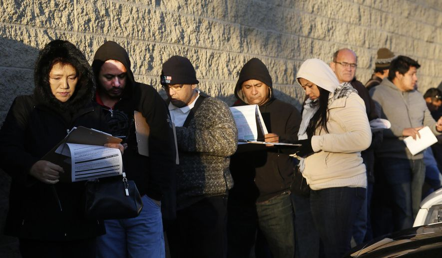 Immigrants line up after spending the night outside a California Department of Motor Vehicles office to register for drivers licenses in Stanton, Calif., on Jan. 2, 2015. Hundreds of people packed into state offices and waited on hours-long lines Friday as California began issuing driver's licenses to the nation's largest population of immigrants in the country illegally. Braving near-freezing temperatures, immigrants donning scarves and gloves and poring over driver's handbooks arrived at the newly-created Department of Motor Vehicles office in Stanton as early as 2 a.m. hoping to be among the first to obtain the long-sought driving permits. (Associated Press) **FILE**
