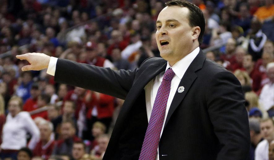 Dayton head coach Archie Miller directs his team against Oklahoma in the first half of an NCAA tournament college basketball game in the Round of 32 in Columbus, Ohio, Sunday, March 22, 2015. (AP Photo/Paul Vernon)