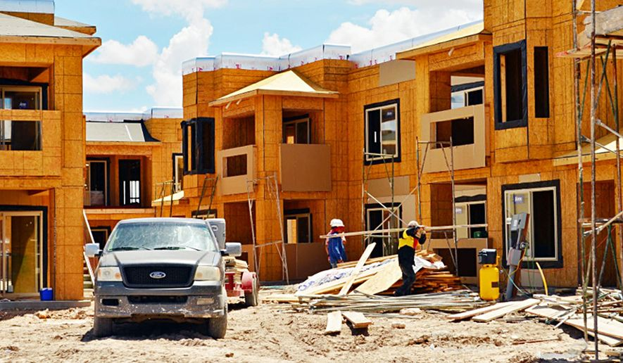 In this July, 2013 photo, construction workers erect the Ledgestone Apartments in east Hobbs, N.M. A portion of southeastern New Mexico's oil patch is again among the top 10 fastest growing areas in the nation, according to new data released Thursday, March 26, 2015 by the U.S. Census Bureau. The Hobbs area saw its population increase more than 2 percent to nearly 70,000 between July 2013 and July 2014. The area's population in 2010 was listed as 64,727. The region includes part of the Permian Basin, which has seen the number of barrels of oil produced each day more than double over the last several years. (AP Photo/Hobbs News-Sun)