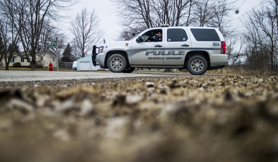Michigan State Police investigate a body found in a pond at the 9500 block of Hammil Road, about one quarter of a mile from its intersection with North Street in Forest Township, just outside Otisville, Mich., Thursday, March 26, 2015. Richfield Township Police and Forest Township Fire Department were called to the scene to assist. (AP Photo/The Flint Journal-MLive.com, ) LOCAL TELEVISION OUT; LOCAL INTERNET OUT