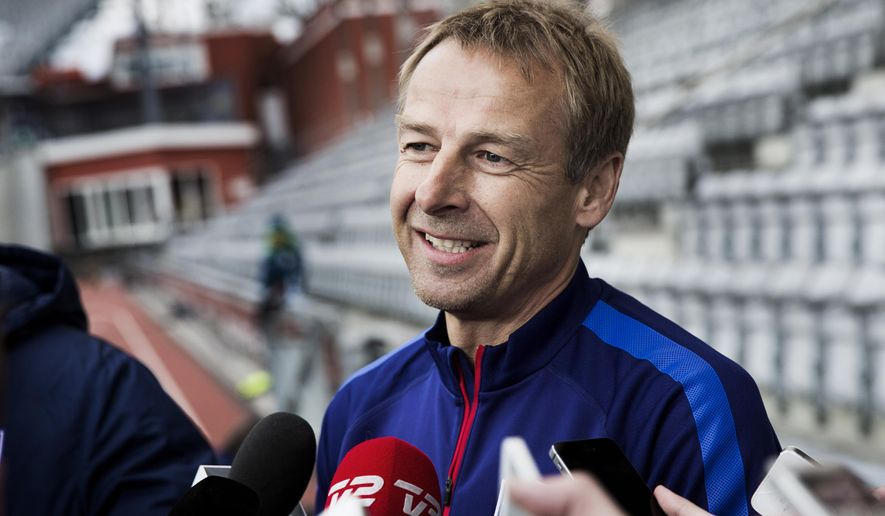 Jurgen Klinsmann, the head coach of the USA national soccer team talks to the media, at NRGI Park stadium in Aarhus, Copenhagen,  Tuesday, March 24, 2015. The team will face Denmark in a friendly international soccer match Wednesday. (AP Photo/ Polfoto, Gregers Tycho)  DENMARK OUT