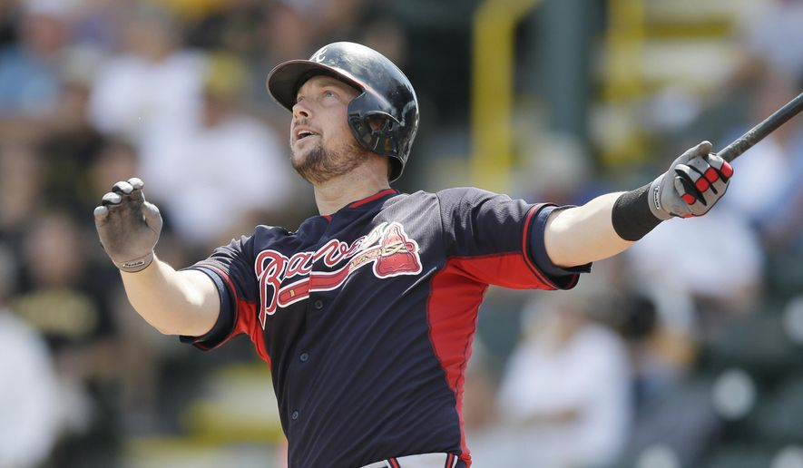 Atlanta Braves' Chris Johnson watches his two-run home run in the first inning of a spring training exhibition baseball game against the Pittsburgh Pirates in Bradenton, Fla., Thursday, March 26, 2015. (AP Photo/Carlos Osorio)