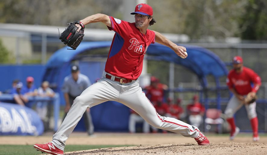 Philadelphia Phillies starting pitcher Cole Hamels (35) winds up in the fourth inning of an exhibition baseball game against the Toronto Blue Jays in Dunedin, Fla., Thursday, March 26, 2015. Hamels allowed no runs on two hits, struck out four and walked three in five innings. (AP Photo/Kathy Willens)
