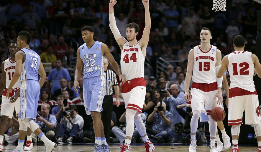 Wisconsin forward Frank Kaminsky (44) reacts next to North Carolina forward Isaiah Hicks (22) after Wisconsin beat North Carolina 79-72 in a college basketball regional semifinal in the NCAA Tournament, Thursday, March 26, 2015, in Los Angeles. (AP Photo/Jae C. Hong)
