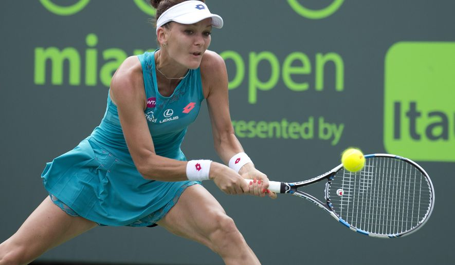 Agnieszka Radwanska, of Poland, returns the ball to Anna Schmiedlova, of Slovakia, during their match at the Miami Open tennis tournament in Key Biscayne, Fla., Thursday, March 26, 2015. (AP Photo/J Pat Carter)