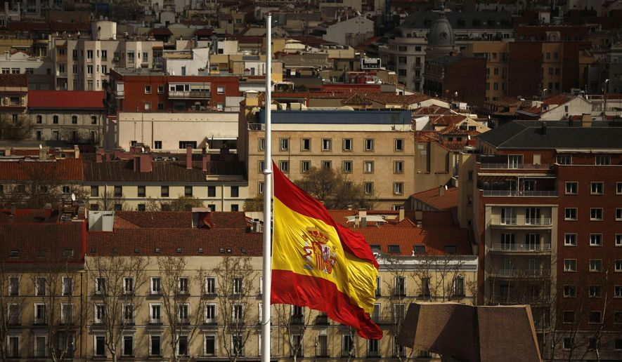 A Spanish flag flies at half staff for the victims of the Germanwings passenger jet, in Madrid, Spain, Wednesday, March 25, 2015. The plane carrying 150 people crashed Tuesday in the French Alps region as it traveled from Barcelona to Duesseldorf in Germany. (AP Photo/Andres Kudacki)