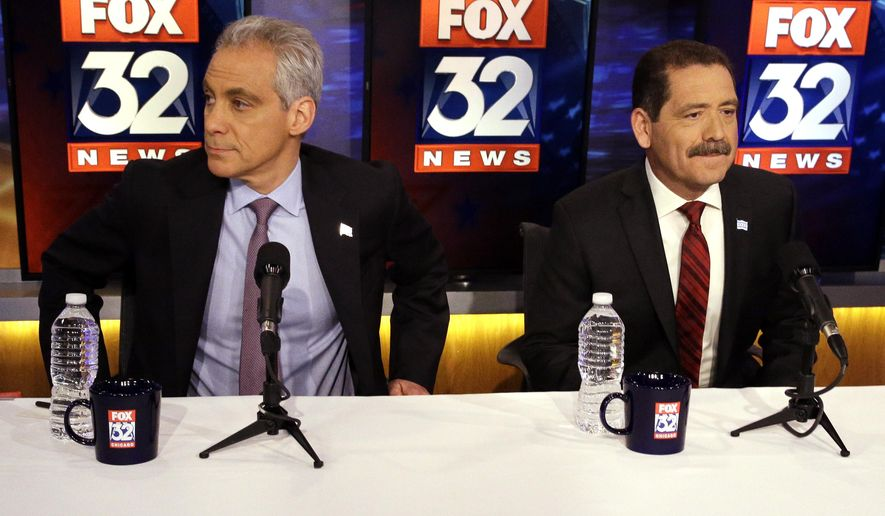 Chicago Mayor Rahm Emanuel, left, and challenger Cook County Commissioner Jesus Garcia meet for their second debate of the runoff election in Chicago, Thursday, March 26, 2015. Emanuel is trying to win his second term on April 7, after failing to win a majority of the vote in February. (AP Photo/Nam Y. Huh)