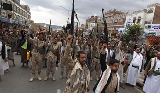 Shiite rebels, known as Houthis, hold up their weapons to protest against Saudi-led airstrikes, as they chant slogans during a rally in Sanaa, Yemen, Thursday, March 26, 2015. Saudi Arabia bombed key military installations in Yemen on Thursday, leading a regional coalition in a campaign against Shiite rebels who have taken over much of the country and drove out the president. (AP Photo/Hani Mohammed)