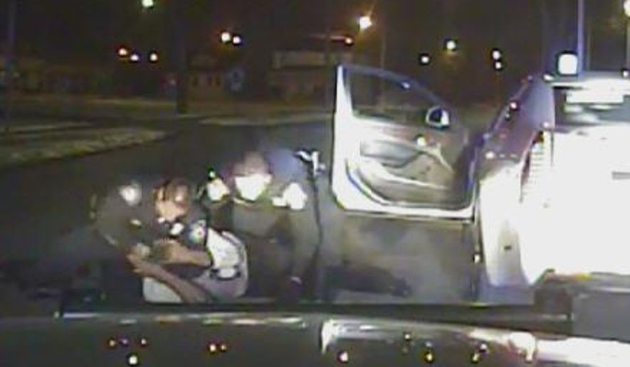 In this Jan. 28, 2015, frame from a dashcam video provided by the Inkster Police Department, an officer punches Floyd Dent many times in the head while another officer tries to handcuff Dent, who is on the ground in Inkster, Mich. Dent's face and shirt were bloodied. Police say Dent disregarded stop signs and refused to pull over, then resisted arrest and threatened them. (AP Photo/Inkster Police Department via Detroit News)