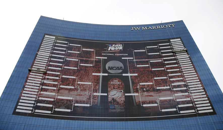 FILE- In this March 16, 2015, file photo, workers add team names to a 2015 NCAA Division I men's basketball tournament bracket that is displayed on the side of the JW Marriott in Indianapolis. With the Final Four a week away from shining a spotlight on Indianapolis, NCAA President Mark Emmert said Thursday, March 26, that the governing body for college sports is concerned about an Indiana law that could allow businesses to discriminate against gay people. (AP Photo/Darron Cummings, File)