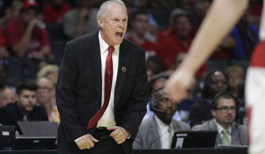 Wisconsin head coach Bo Ryan reacts during the first half of a college basketball regional semifinal against North Carolina in the NCAA Tournament, Thursday, March 26, 2015, in Los Angeles. (AP Photo/Jae C. Hong)