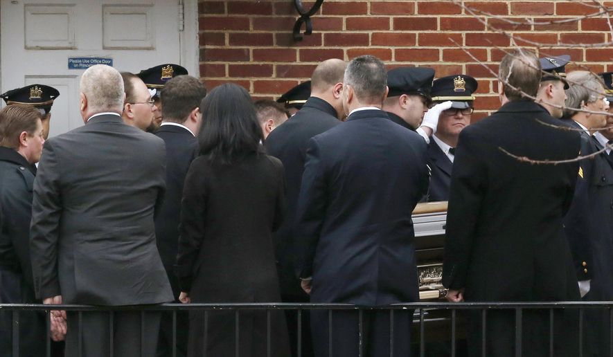 Pallbearers carry the casket containing the body of Linden Officer Frank Viggiano in Linden Presbyterian Church, before funeral services, Thursday, March 26, 2015, in Linden, N.J. Viggiano and Joseph Rodriguez died when the car they were riding in crashed head-on into a truck in the Staten Island borough of New York on Friday after a night at a strip club. Officers Pedro Abad Jr., who was driving the car, and Patrik Kudlac, remain hospitalized. The officers were off-duty at the time. (AP Photo/Julio Cortez)