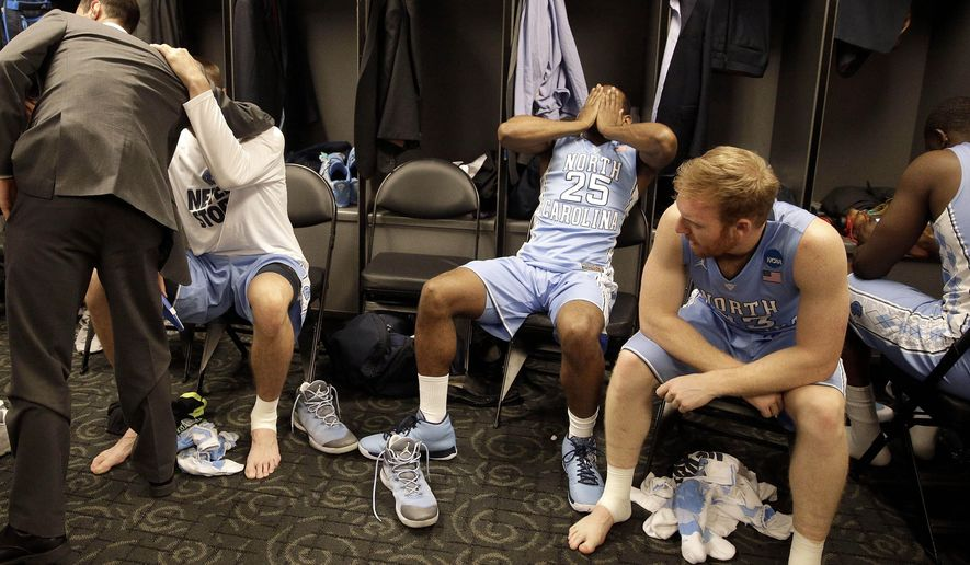 North Carolina guard Justin Coleman (25) reacts alongside teammate guard Spenser Dalton, right, after their loss to Wisconsin in a college basketball regional semifinal in the NCAA Tournament, Thursday, March 26, 2015, in Los Angeles. Wisconsin won 79-72. (AP Photo/Jae C. Hong)