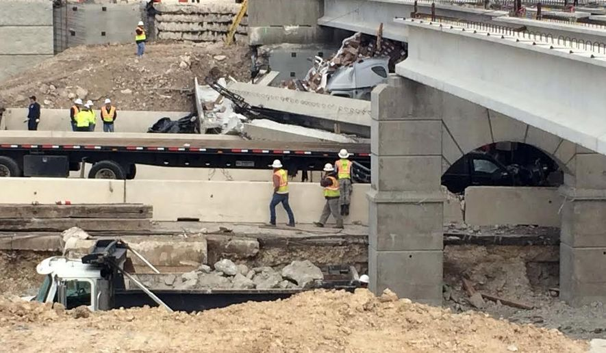 Authorities investigate a a tractor-trailer that crashed into an overpass under construction on Thursday, March 26, 2015 in Salado, Texas.   Department of Transportation spokeswoman Becky Ozuna says the truck hit a beam being used to build a bridge across Interstate 35 on Thursday morning in Salado, about 40 miles north of Austin. She says several beams then toppled onto other vehicles.  Department of Public Safety spokesman Trooper D.L. Wilson says one person was killed and other people were injured, but he didn't immediately have further details. (AP Photo/The Temple Daily Telegram, Rusty Schramm )