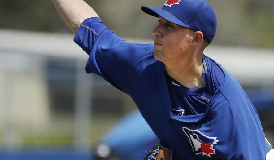 Toronto Blue Jays starting pitcher Aaron Sanchez (41) delivers in the fourth inning of an exhibition baseball game against the Philadelphia Phillies in Dunedin, Fla., Thursday, March 26, 2015. (AP Photo/Kathy Willens)