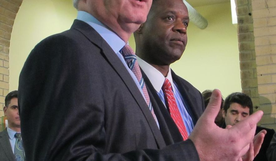 In this Jan. 22, 2015 photo, Kevin Lavin, left, an Kevyn Orr, right, appear at a news conference, in Atlantic City, N.J., after New Jersey Gov. Chris Christie appointed them as emergency managers to recommend ways to turn around the city's finances. On Thursday, March 26, 2015, Wall Street ratings agencies expressed concerns about whether proposed layoffs and spending cuts will be enough to help the city. (AP Photo/Wayne Parry)