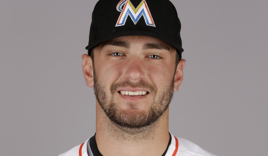FILE - This is a 2015, file photo showing Jarred Cosart of the Miami Marlins baseball team. Marlins pitcher Jarred Cosart says Major League Baseball is reviewing his deleted Twitter account as part of an investigation into gambling-related tweets posted there and he is cooperating with the investigation. The 24-year-old Cosart deleted his Twitter account Tuesday, March 24, 2015, after screen shots of comments he purportedly made appeared on the website of Miami New Times. (AP Photo/Jeff Roberson, File)