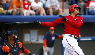 Washington Nationals first baseman Kila Ka'aihue (18) bats in an exhibition spring training baseball game against the Houston Astros Friday, March 13, 2015, in Viera, Fla. (AP Photo/John Bazemore)