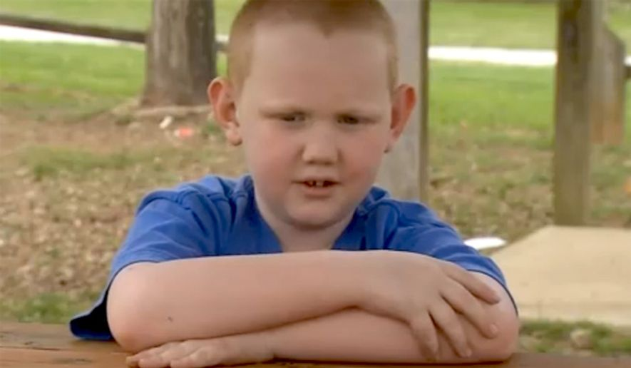 "Seven-year-old Adam Stinnett was not allowed back into his classroom at Bobby Ray Memorial Elementary School in Tennessee until his ""high and tight"" military-style haircut was removed. (Image: Fox 17, Nashville)"