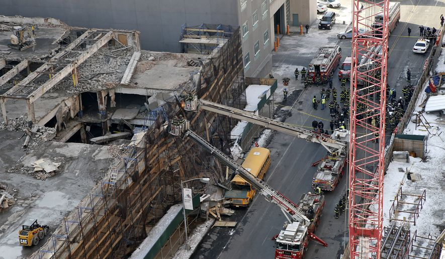 At least 30 people were injured and others could be trapped in a five-story Manhattan building that caught fire and collapsed Thursday, New York police said