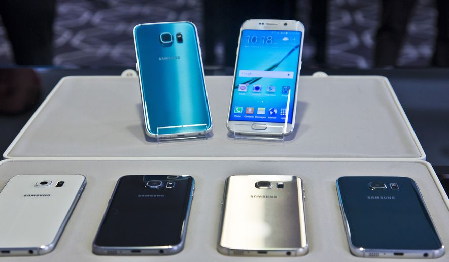 In this Feb. 23, 2015, file photo, two new Samsung phones, Galaxy S6, top left, and Galaxy S6 Edge, to right, are on display with choice of color selections at a special media preview in New York. Orders for Samsung's Galaxy S 6 phones start Saturday, March 28, 2015, with delivery around April 10. (AP Photo/Bebeto Matthews, File)