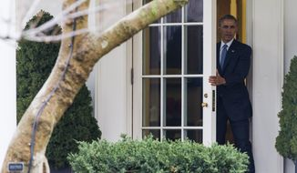 President Barack Obama walks out of the Oval Office of the White House in Washington, Thursday, March 26, 2015, to board Marine One on the South Lawn for a short trip to Andrews Air Force base Md., before traveling to Lawson State Community College in Birmingham to speak about the economy. (AP Photo/ Evan Vucci)
