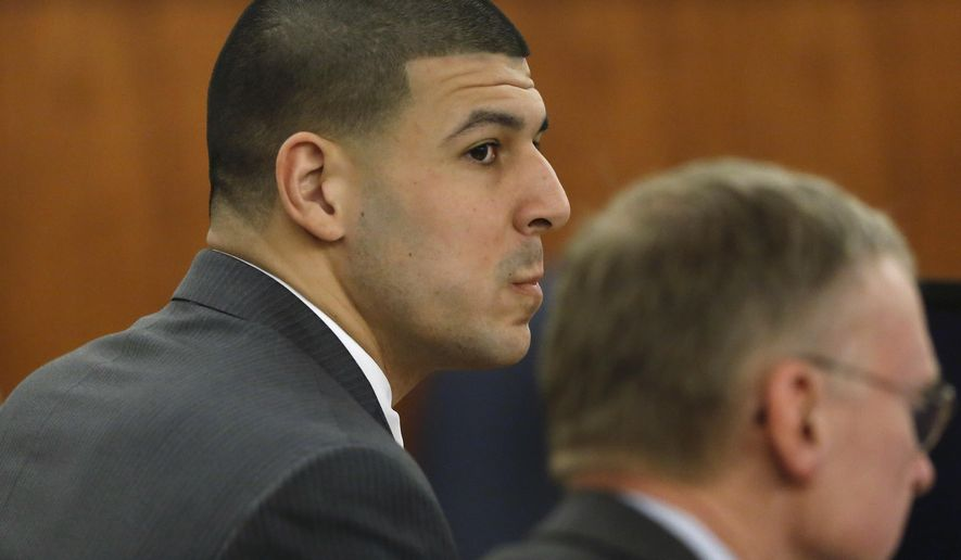 Former New England Patriots football player Aaron Hernandez, left, sits with his defense attorney Charles Rankin during his murder trial Thursday, March 26, 2015, in Fall River, Mass. Hernandez is charged with killing Odin Lloyd. (AP Photo/Steven Senne, Pool)