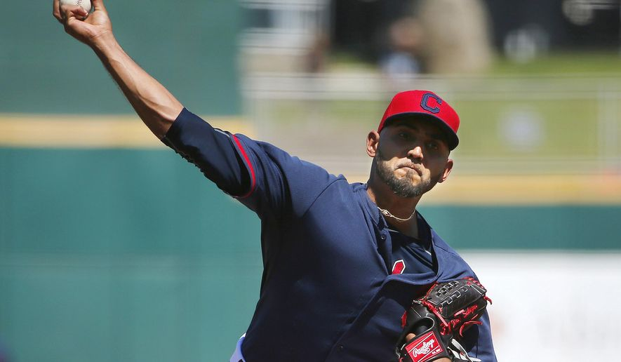 Cleveland Indians' Danny Salazar throws a pitch against the Cincinnati Reds during the second inning of a spring training baseball game Thursday, March 26, 2015, in Goodyear, Ariz. (AP Photo/Ross D. Franklin)