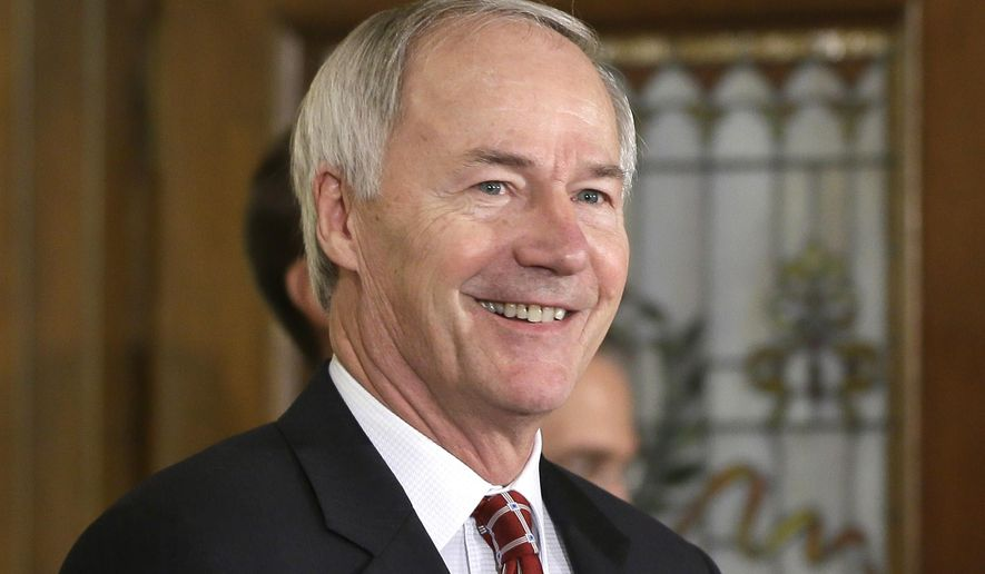 Arkansas Gov. Asa Hutchinson walks to a news conference at the Arkansas state Capitol in Little Rock, Ark., Thursday, March 26, 2015. Hutchinson said Thursday he would sign into law a religious protection measure that opponents have said would open the door to state-sanctioned discrimination against gays and lesbians. (AP Photo/Danny Johnston)