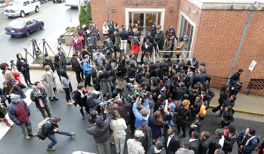 University of Virginia students and supporters of Martese Johnson stand outside Charlottesville General District Court on Thursday, March 26, 2015 in Charlottesville, Va.  Johnson's case was continued until state police complete an investigation into his arrest March 18 outside a Charlottesville bar. The 20-year-old Chicago man is charged with public intoxication and obstruction of justice. Johnson's arrest March 18 has drawn wide attention because images of him with a bloody face spread quickly on social media. (AP Photo/The Daily Progress, Andrew Shurtleff)