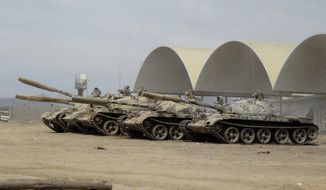 In this photo taken Tuesday, March 24, 2015, tanks seized recently by militiamen loyal to Yemen's President Abed Rabbo Mansour Hadi take positions at the Al-Anad Air Base in the southern province of Lahej, 60 kilometers (35 miles) north of Aden, Yemen. (AP Photo/Wael Qubady) ** FILE **