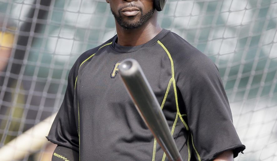Pittsburgh Pirates center fielder Andrew McCutchen is seen during batting practice before a spring training exhibition baseball game against the Atlanta Braves in Bradenton, Fla., Thursday, March 26, 2015. McCutchen had his dreadlocks cut for charity. (AP Photo/Carlos Osorio)