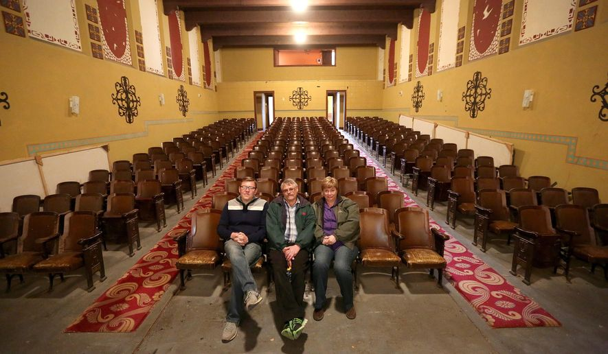 From left to right, Brandon Taylor, Leif Johansson, and Wendy Faldowski pose together in the historic Sinclair Theatre on Tuesday afternoon, March 17, 2015, in Sinclair, Wyo. The three are collaborating to raise funds to restore the building, which was built in 1924 in the former company town near Rawlins. (AP Photo/Casper Star-Tribune, Dan Cepeda)