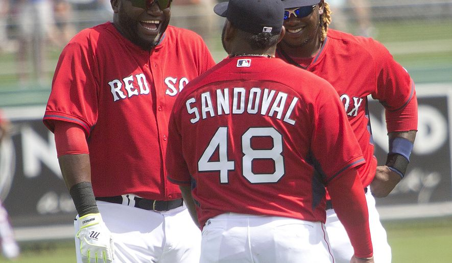 FILE - In this March 3, 2015, file photo, Boston Red Sox players, from left, David Ortiz, Pablo Sandoval and Hanley Ramirez chat during a spring training exhibition baseball game against Northeastern in Fort Myers, Fla. As Major League Baseball launches speed-up rules this year, a lot of teams are on the clock. Pablo Sandoval, Hanley Ramirez and the remade Boston Red Sox, Nelson Cruz with the run-starved Seattle Mariners, Jimmy Rollins and the just-keep-missing Los Angeles Dodgers. (AP Photo/The News-Press, Andrew West)  MAGS OUT; NAPLES OUT;  NO SALES