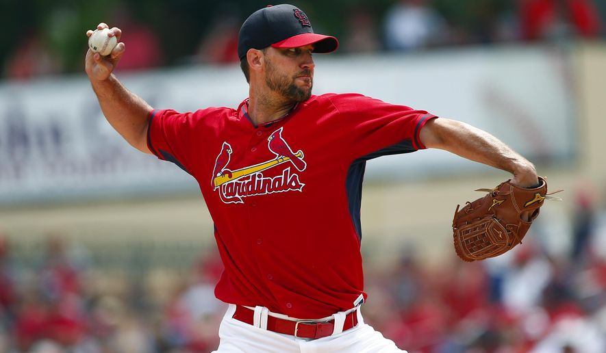 St. Louis Cardinals starting pitcher Adam Wainwright delivers in the first inning of an exhibition spring training baseball game against the Miami Marlins, Thursday, March 26, 2015, in Jupiter, Fla. (AP Photo/John Bazemore)