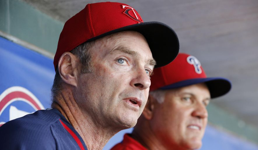 FILE - This March 23, 2015, file photo shows Minnesota Twins manager Paul Molitor, left, and Philadelphia Phillies manager Ryne Sandberg sitting in the dugout together  before a spring training baseball game between their two teams in Clearwater, Fla. Hall of Famer Molitor is among six new baseball managers.  (AP Photo/Kathy Willens, File)