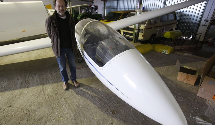 Aviation club member Peter Ruecker stands beside a glider that was flown by Andreas Lubitz in the hangar of the club in Montabaur, Germany, Thursday, March 26, 2015. Lubitz was the copilot on flight Germanwings 9525 that crashed with 150 people on board on Tuesday in the French Alps. (AP Photo/Michael Probst)